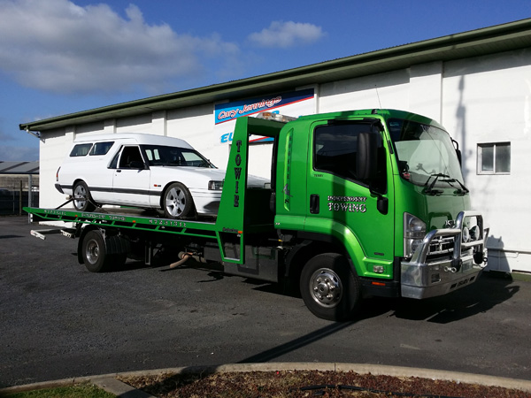 Towing on Eyre Peninsula white ute with covered tray on a tilt truck