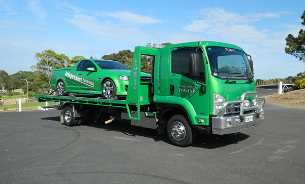 Ceduna towing tow truck with ute loaded on to tilt tray truck